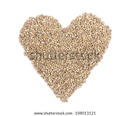 Hemp seeds in heart shape on white background. - stock photo