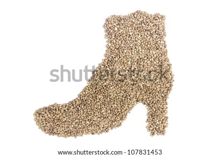 Hemp seeds in shape of woman's shoe on white background