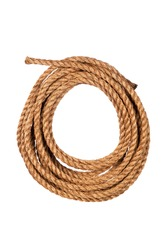 Hemp three strand rope coiled in a circluar pattern isolated against a white background.