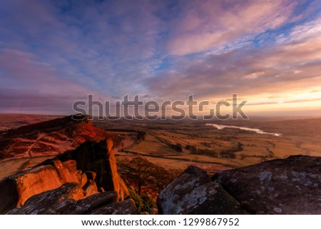 Hen Cloud and Tittesworth Reservoir from the Roaches at sunset. Peak District sandstone and the Staffordshire moorlands.