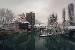 Henkersteg in the historic oldtown of Nuremberg during winter with snow and ice