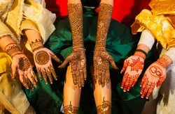 Henna is applied to the hands of a beautiful  Hindu Bride on her wedding.