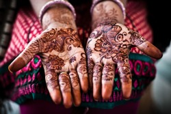 Henna on an unidentified womans hand in Rajasthan, India