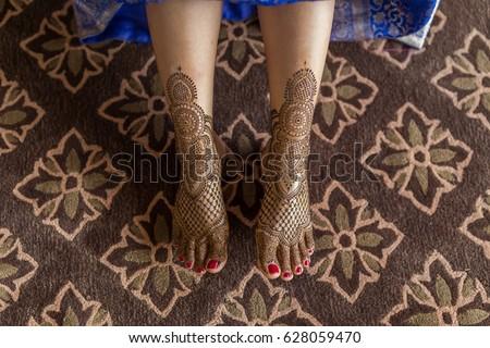henna tattoo on foot #628059470