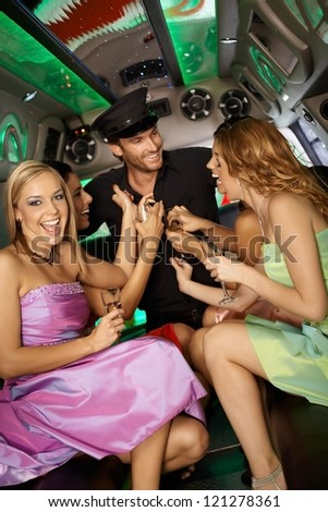 Hens night in limousine with beautiful girls and handsome man.