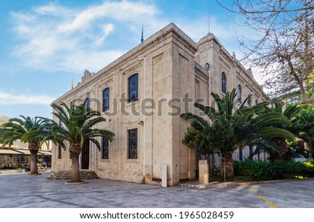 Heraklion, Crete Island, Greece: The church of Agios Titos is an Orthodox church in Heraklion, dedicated to Saint Titus. The church was built in 1869. Exterior angled view on a sunny day, cloudy sky Stock fotó ©