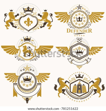 Heraldic signs decorated with vintage elements, monarch crowns, religious crosses, armory and animals. Set of classy symbolic graphic insignias with bird wings.