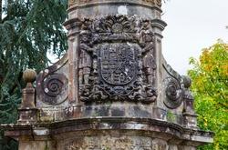 Heraldic stone shield of Rubalcaba Cross of Miera-Rubalcaba palace in Liérganes village of Pasiegos valleys of Cantabria Autonomous Community of Spain, Europe