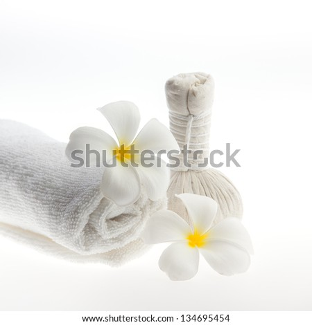 Herb ball beside white towel decorate with white flower against white background