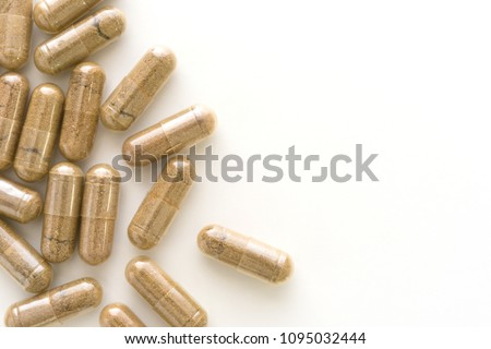 Herb capsule, Nutritional Supplement, Vitamin Pill, Herbal Medicine on white background.