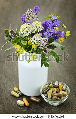 Herb plants with mix of alternative medicine herbal supplements and pills