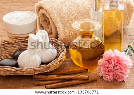 Herbal and oil treatment equipment in relaxing spa setting.