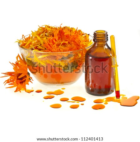 herbal calendula in the glass and aromatherapy essential oil Isolated white background
