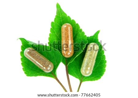 herbal capsules on melissa leaves