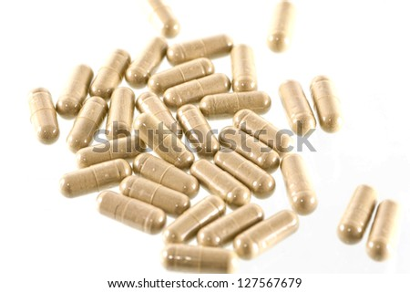 herbal capsules on white