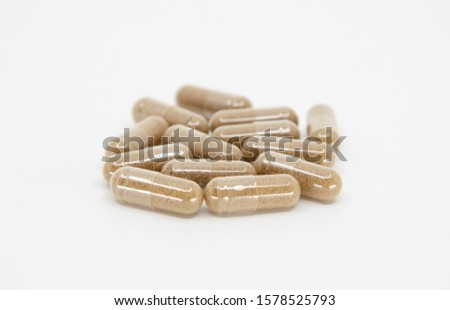 herbal capsules on white background