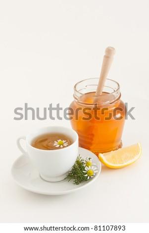 Herbal chamomile tea with honey and lemon