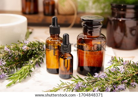 Herbal essential oil on vintage apothecary bottles. Alternative medicine, skin care, aromatherapy and natural medicine