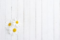 herbal flowers on white wood table