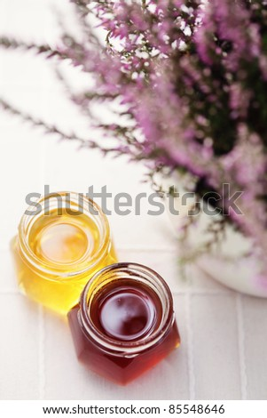herbal honey in jar with fresh heather - sweet food /shallow DOF/