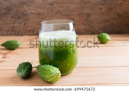 Shutterstock Herbal juice of green momodica , Balsam apple, Balsam pear, Bitter cucumber , Bitter gourd , Stuffed bitter gourd, karela in a glass with sliced vegetables, karela juice or bitter gourd juice