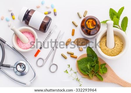 Herbal medicine VS Chemical medicine the alternative healthy care on white background. Foto stock ©