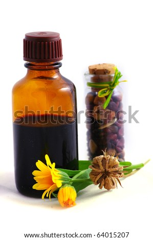 Herbal medicine with herbs with place gor text. Isolated white background. Studio shot.