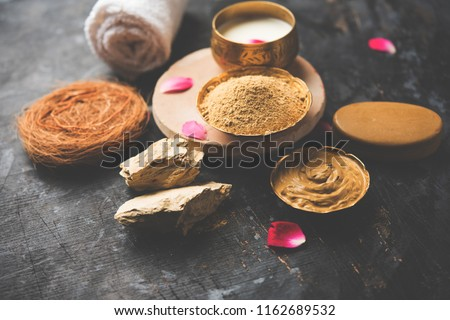 Herbal or Ayurvedic face Pack using Multani mitti, milk etc placed with Soap, towel. Selective focus