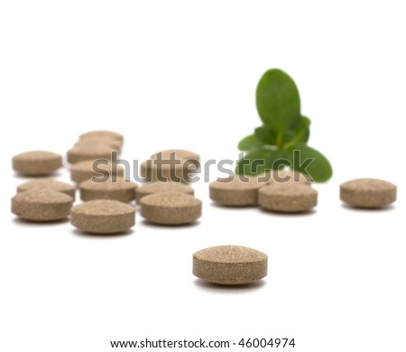 herbal pills isolated on white background - stock photo