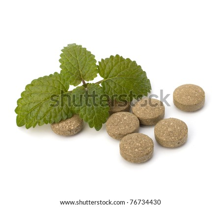 Herbal pills isolated on white background. Alternative medicine concept. - stock photo