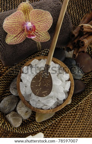 herbal salt with b orchid and spoon on straw mat