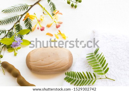 herbal soap extract vegetation tamarind health care for body skin with terry cloth of lifestyle clean a bath arrangement flat lay style on background white.