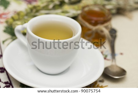 Herbal tea and fresh honey, shallow dof