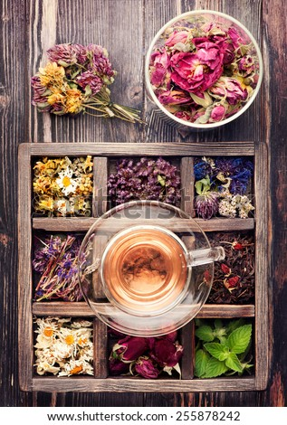Herbal tea, dried flowers and dried herbs in a vintage box. top view