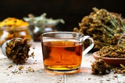 herbal tea in glass on stone table background