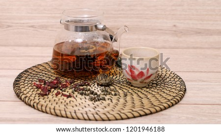 herbal tea in glass teapot for use, health and soothing