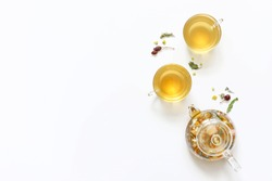 Herbal tea of mint, chamomile, rose hip and other herbs on white background. The view from the top. Copy space