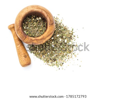 Herbal tea or dry herb in mortar and pestle, top view, on white background Foto stock ©