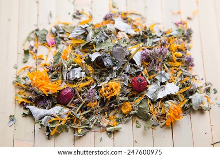 Herbal tea with dry flowers and berries