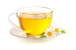 Herbal tea with fresh chamomile flowers isolated on white background