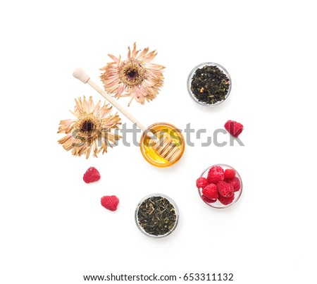 Herbal tea with honey, wild berry and flowers on white background. Flat lay, copy space