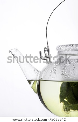 Herbal tea with leaves & lemon - shallow dof