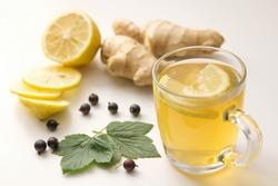 Herbal tea with lemon and ginger. Healthy diet. Slimming tea.