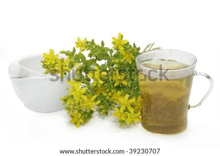 Herbal tea with Saint-John's wort over white background
