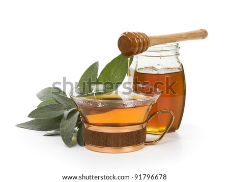 Herbal tea with salvia and honey on white background