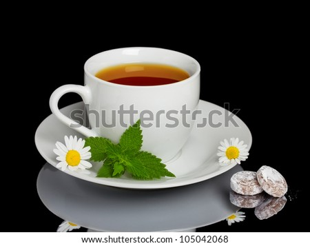 Herbal tea with sweet candies - stock photo