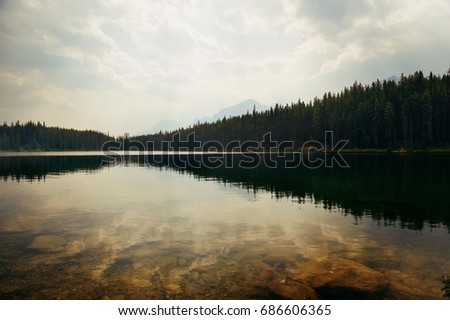 Stock Photo Herbert Lake with forest lake reflection and mountain range