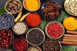 Herbs and spices in metal bowls. Food and cuisine ingredients. Colorful natural additives.