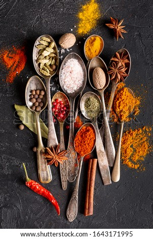 Herbs and spices on a wooden board,Spice spoon.