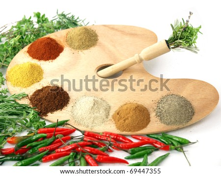 Herbs and spices on a wooden palette